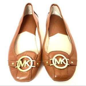 Michael Kors brown leather flats with golden logo